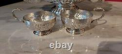 An Antique Silver Plated Punch Bowl. 6 Cups And Ladle. All With Embossed Patterns