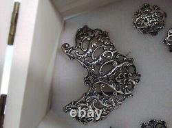 Silver c1903 Samuel Jacob's nurses buckles with buttons. All hallmarked clearly
