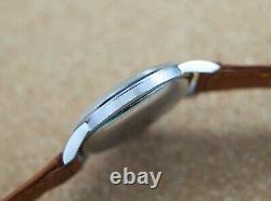 Vintage men's Zenith Sporto manual wind 37mm all steel original dust cover rare