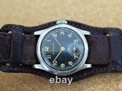 Vintage mens Eterna military manual wind all original s. Steel case black dial